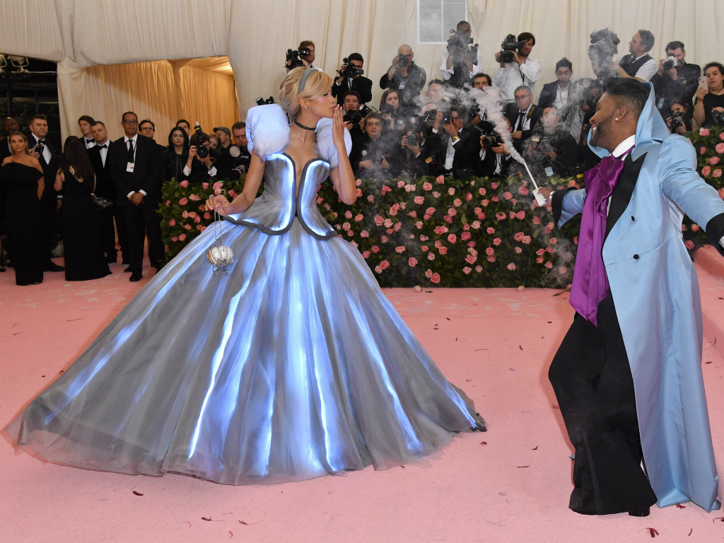 Zendaya went full Cinderella in a light-up Tommy Hilfiger gown with stylist Law Roach (with smoking wand, right) playing the role of the transformative fairy godmother. Zendaya was already on our list of favorites -- even before she left a glass slipper on the pink carpet on the way into the gala.