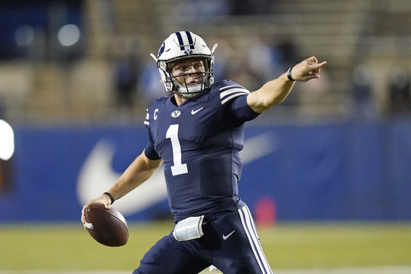 BYU quarterback Zach Wilson (1) looks down field in the first half during an NCAA college football game against Texas State Saturday, Oct. 24, 2020, in Provo, Utah. (AP Photo/Rick Bowmer)