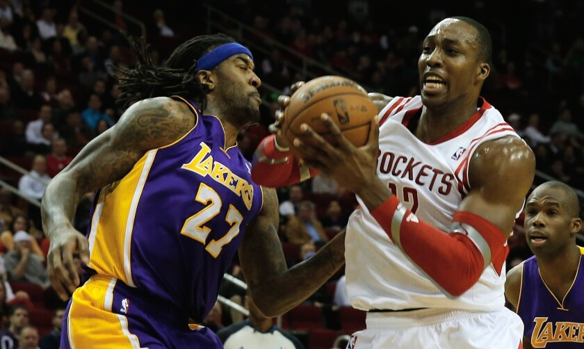 Rockets center Dwight Howard tries to drive past Lakers power forward Jordan Hill during a game earlier this season in Houston
