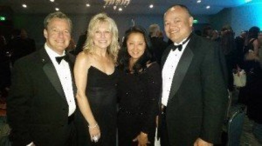 Richard and Kris Gelbart (left) with their friends Mae and Curtis Chan at the 2014 Miracle Makers Gala. Courtesy photo