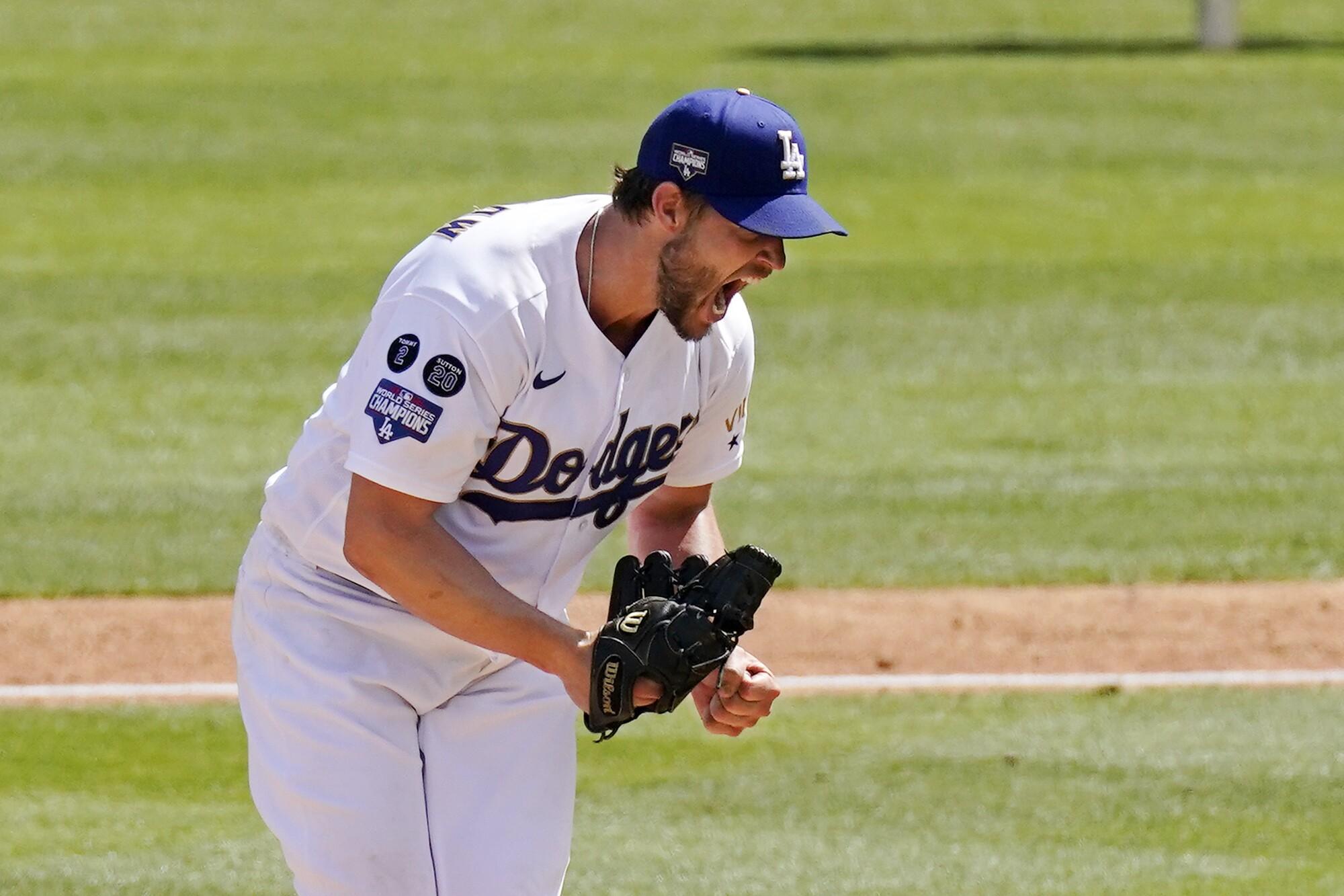 Los Angeles Dodgers starting pitcher Clayton Kershaw celebrates after striking out Washington Nationals' Jordy Mercer.