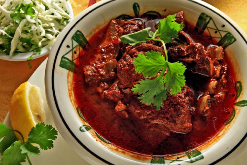 Oaxacan barbecued goat is flavored with dried red chiles, cloves and ripe tomatoes.