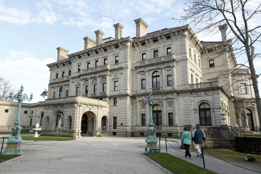 FILE - In this Dec. 1, 2014 file photo, visitors walk toward an entrance to The Breakers mansion in Newport, R.I. Twenty-one members of the Vanderbilt family wrote a letter to the preservation group that owns it, saying its management is no longer fulfilling its commitment to the public trust and i