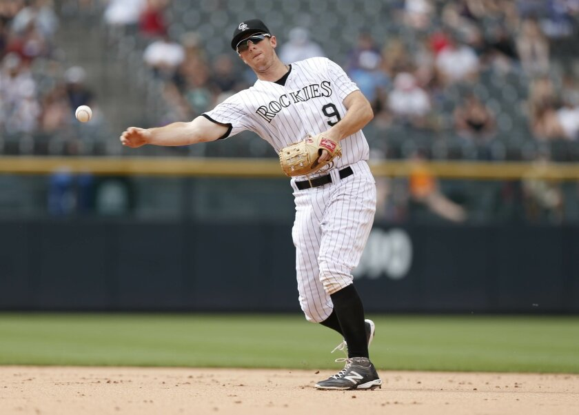 FILE - In this Sunday, Aug. 16, 2015 file photo, Colorado Rockies second baseman DJ LeMahieu (9) throws to first base for put out against the San Diego Padres in the eighth inning of a baseball game in Denver. All-Star second baseman DJ LeMahieu and the Colorado Rockies agreed to a $7.8 million, tw