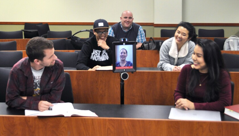 UC Irvine law student Tess Messiha (center) attended her classes virtually via a robot for three wee