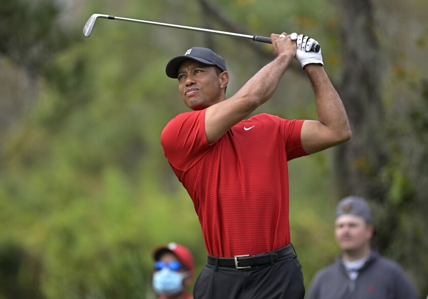 Tiger Woods feels stiff after surgery, hopes to play Masters - Los Angeles  Times