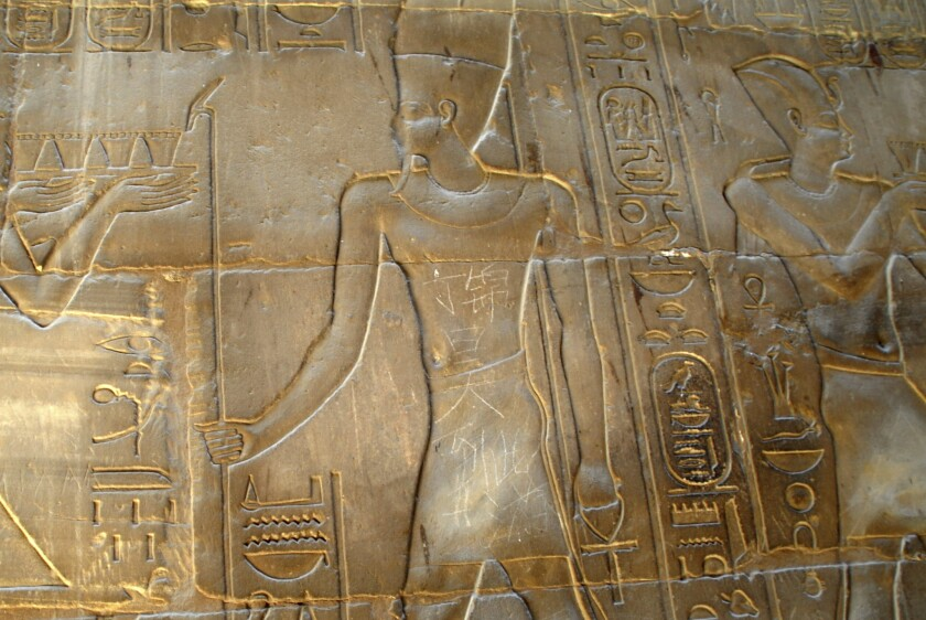 """The message """"Ding Jinhao was here,"""" written in Chinese, is visible on a bas-relief in the 3,500-year-old temple in Luxor, Egypt."""