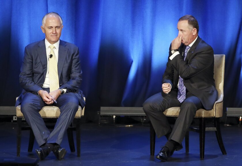 New Zealand Prime Minister John Key, right, and Australian Prime Minister Malcolm Turnbull participate in a Q and A session at the Trans-Tasman Business Circle lunch in Sydney, Friday, Feb. 19, 2016. (AP Photo/Rick Rycroft)