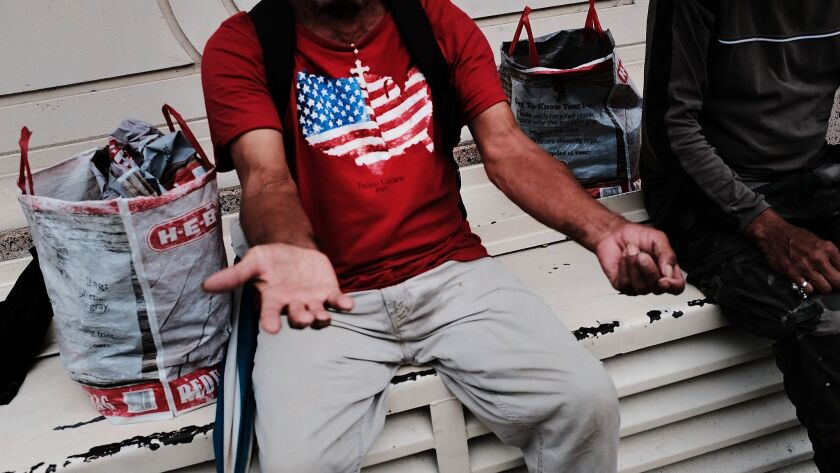 A homeless man sits on a bench in Brownsville, Texas, on June 21.