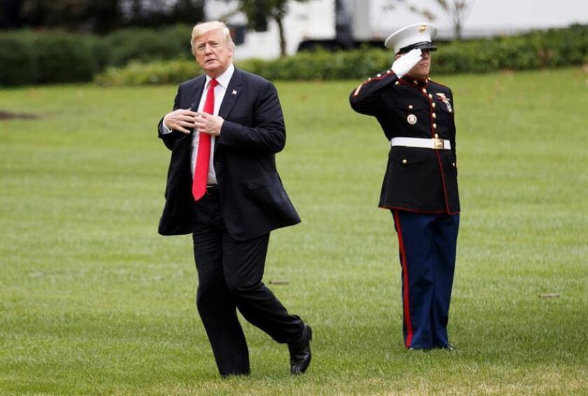 El presidente estadounidense, Donald Trump (c), a su llegada a la Casa Blanca en Washington, Estados Unidos, hoy, 27 de septiembre de 2018, tras la 73 Asamblea General de Naciones Unidas (ONU) celebrada en Nueva York. EFE