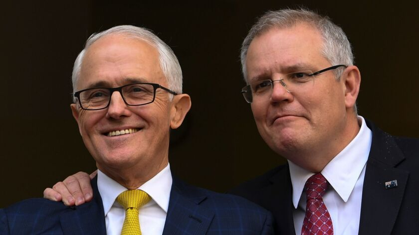 Outgoing Australian Prime Minister Malcolm Turnbull, left, and Treasurer Scott Morrison appear at a news conference at Parliament House in Canberra, Australia, on Aug. 22, 2018. Morrison replaced Turnbull on Friday.