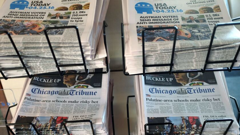 Copies of the Chicago Tribune and USA Today are displayed at Chicago's O'Hare International Airport.