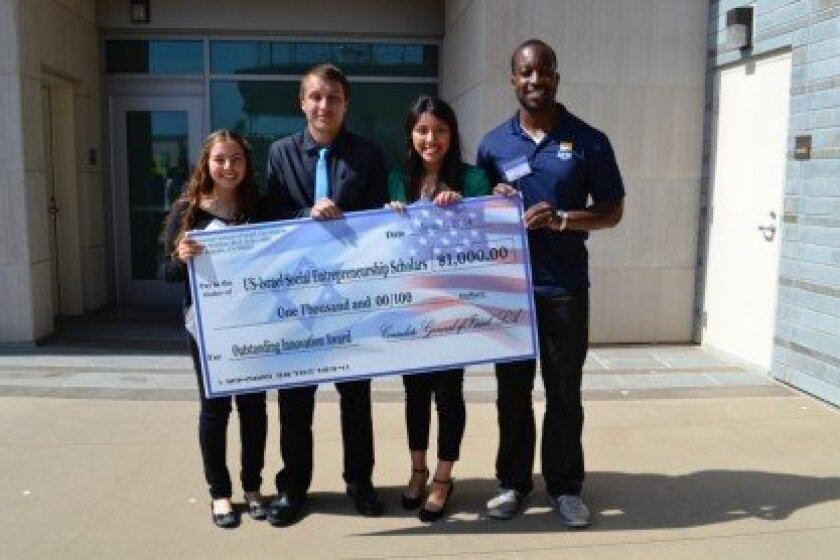 Tali Edid, far left holds her Social Entrepreneurship Youth Training Program award grant with colleagues Noah Villalobos, Vanessa Ramirez and mentor Seyi Oshinowo.