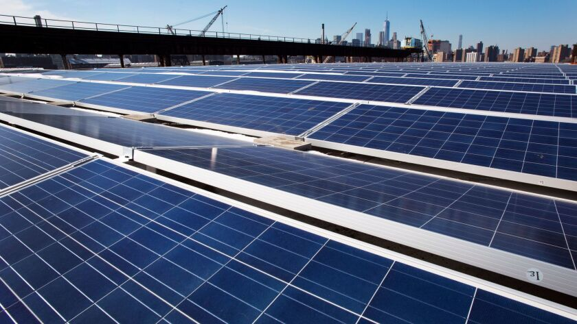FILE - In this Feb. 14, 2017, file photo, a rooftop is covered with solar panels at the Brooklyn Nav