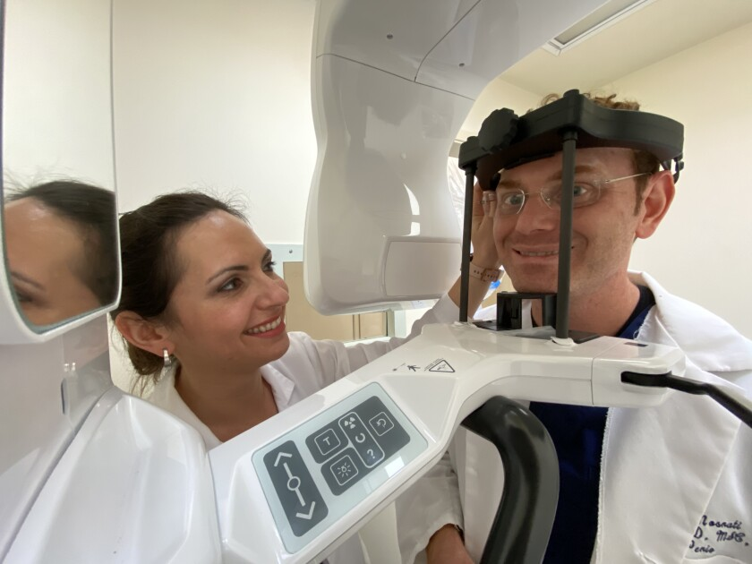 Dr. Irene Nosrati demonstrates La Jolla Dental Boutique's new CT machine on her husband, Dr. Erez Nosrati.