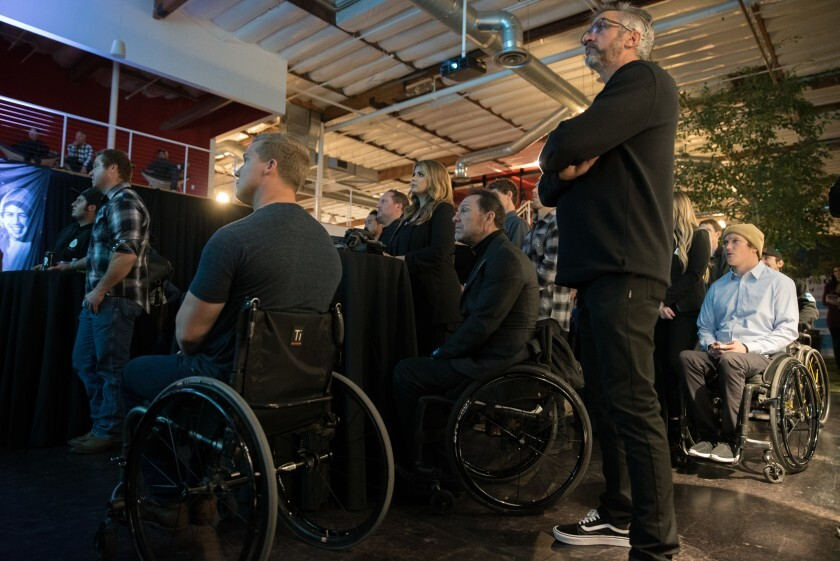 """Athletes, employees and volunteers gather to watch the premiere episode of the """"Road 2 Recovery"""" documentary web series at Fox HQ in Irvine on Dec. 12. The series profiles five injured motorcycle and BMX athletes supported by the Road 2 Recovery Foundation in Encinitas."""