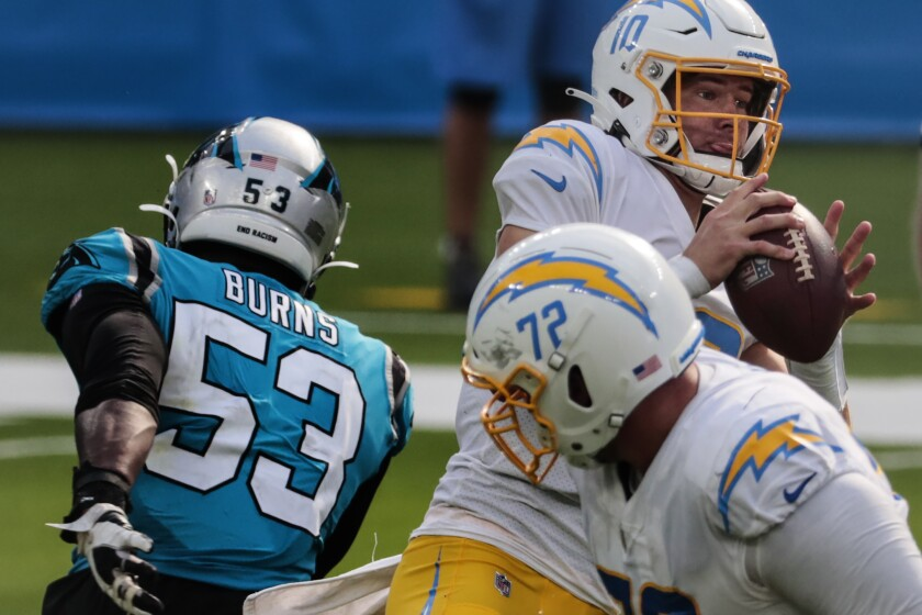 Chargers quarterback Justin Herbert prepares to throw against the Carolina Panthers.