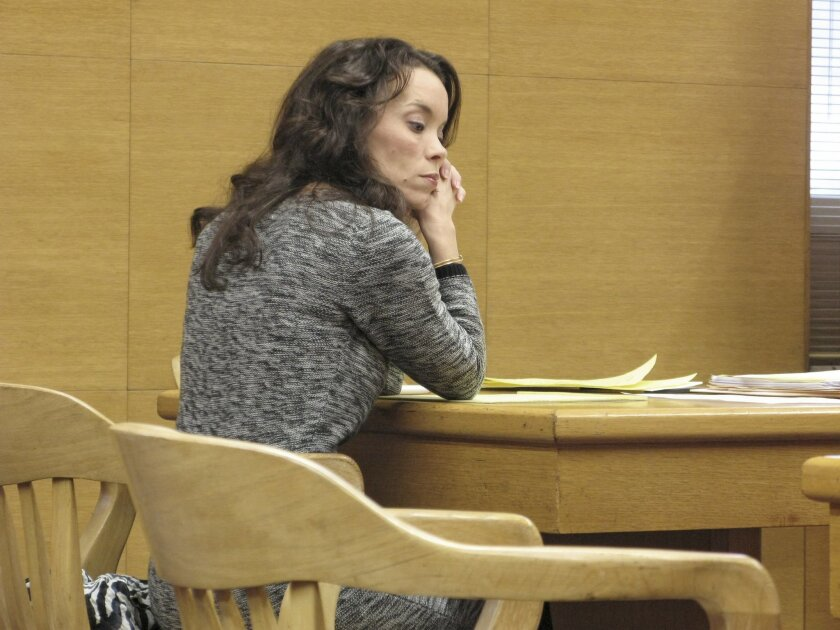 Lynnett Gorman sits in court , Wednesday, Jan. 8, 2014 in Steubenville, Ohio. Gorman, an eastern Ohio elementary school official,  will perform community service related to rape awareness in exchange for prosecutors dropping a charge that she failed to report rumors of a teenage sex and drinking pa