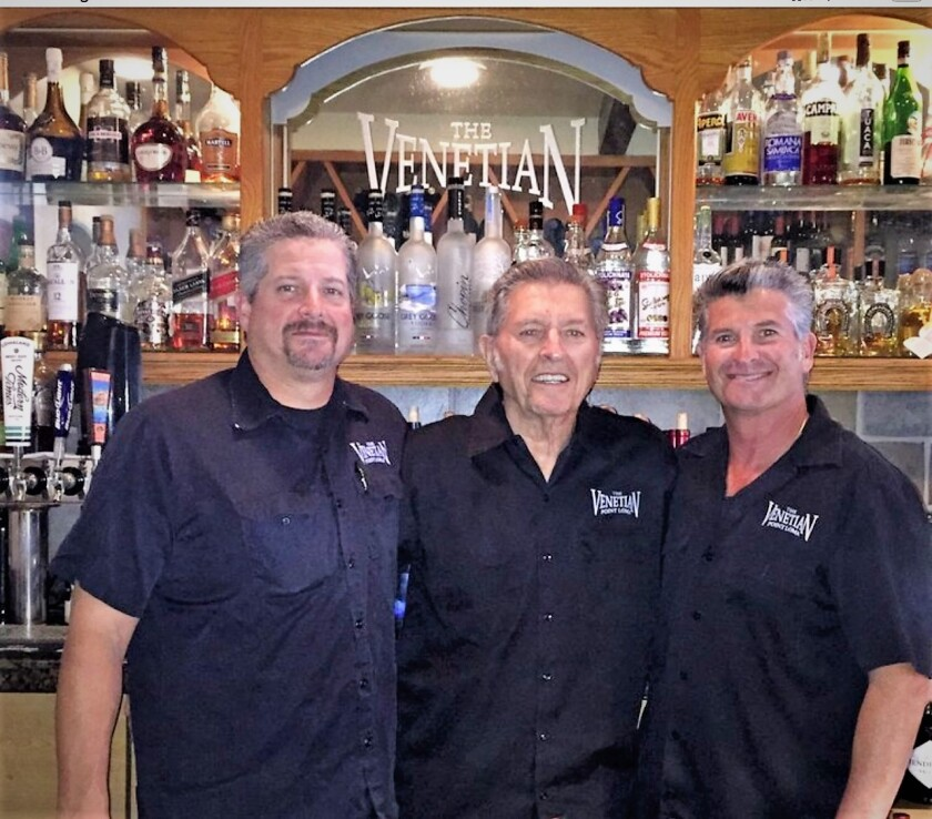 Vince Giacelone (center) founded The Venetian restaurant in Point Loma in 1965. It is now owned and operated by his sons, Frank (left) and Joe (right). They are selling the business to John Rudolph, who owns Harry's Coffee Shop in La Jolla. He plans to run The Venetian much as it has been in the past.