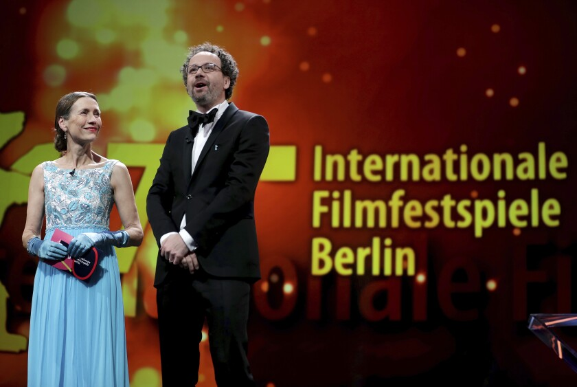 FILE - In this Saturday, Feb. 29, 2020 file photo, Berlinale heads Mariette Rissenbeek, left, and Carlo Chatrian, right, attend the award ceremony of the 2020 Berlinale Film Festival in Berlin, Germany. A six-member jury of former winners has been chosen to allocate the prizes at this year's Berlin International Film Festival, which is taking place in a revamped form because of the coronavirus pandemic. (AP Photo/Michael Sohn, file)