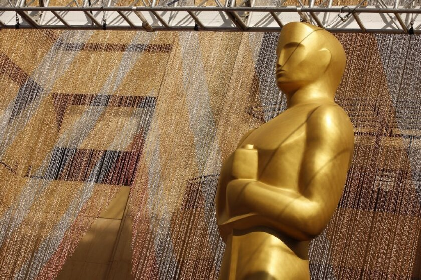 A colorful chain curtain is the backdrop for a giant Oscar statue at Hollywood and Highland for the ceremony on Feb. 26.