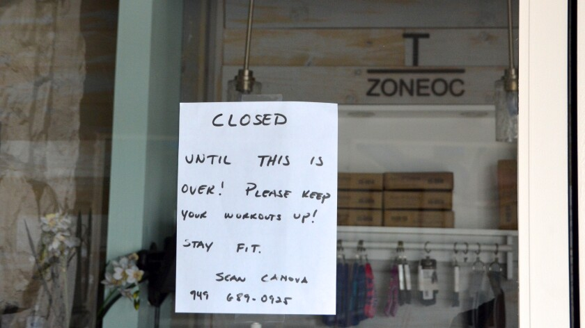 A message from Sean Canova, owner of Training Zone in Costa Mesa, tells customers the gym is closed because of restrictions on nonessential businesses during the coronavirus crisis.