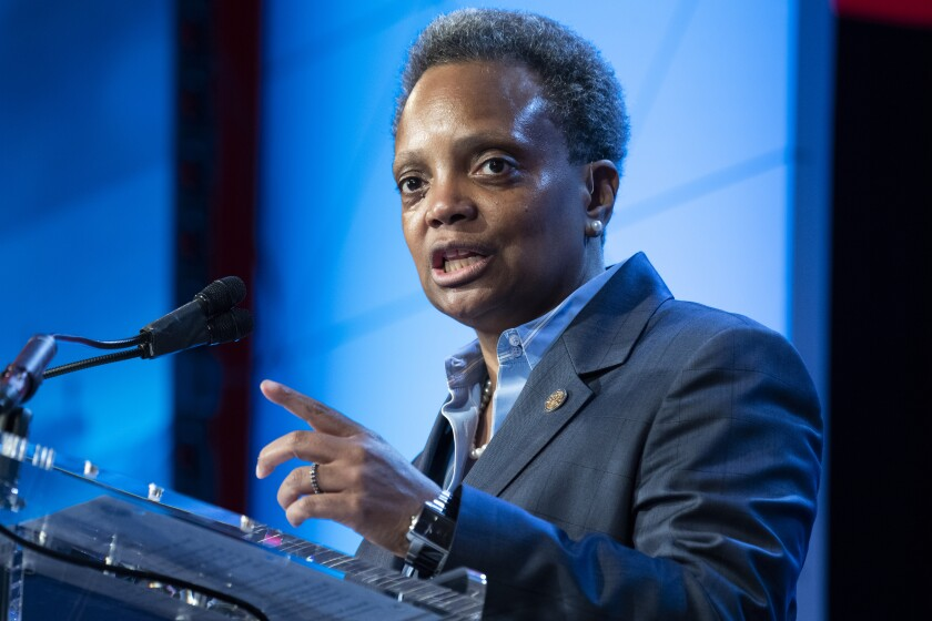 Chicago Mayor Lori Lightfoot speaks at a meeting