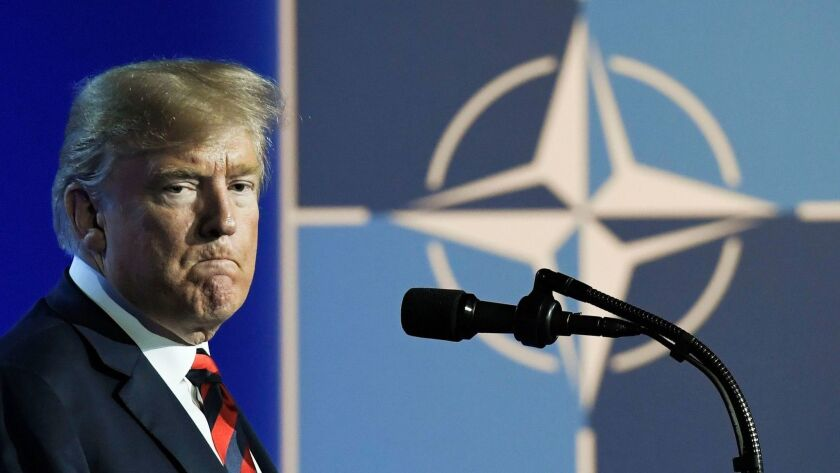 President Trump speaks during a news conference at the NATO summit in Belgium on Thursday.