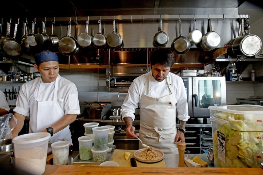 Chef Ludo Lefebvre, right, works in the open kitchen with Ryan Wong at Trois Mec in 2013