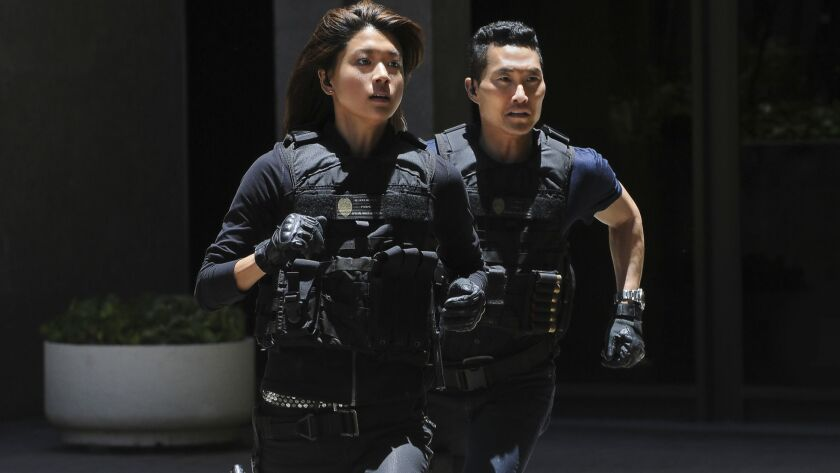 "Grace Park, left, and Daniel Dae Kim quit CBS' ""Hawaii Five-0"" amid claims of pay inequity. CBS says"