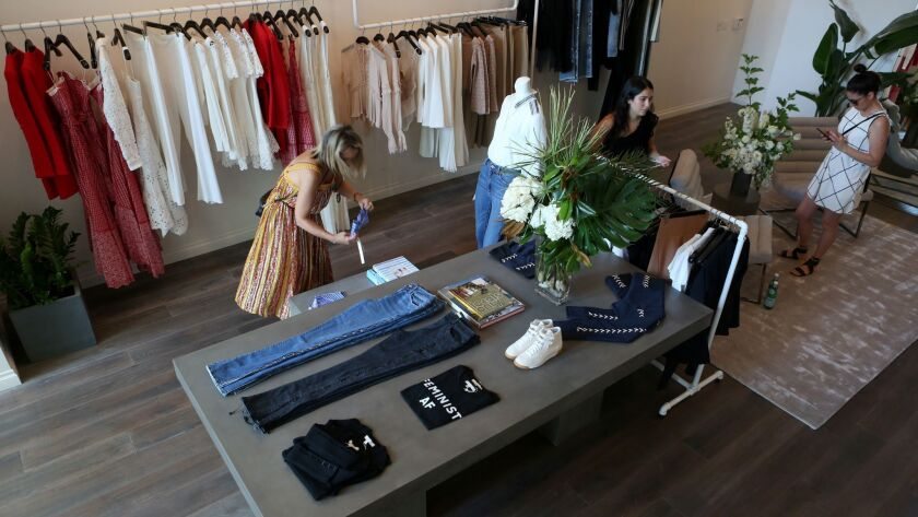 WEST HOLLYWOOD, CA- July 31, 2018: Shoppers browse inside the new Jonathan Simkhai retail store, ate