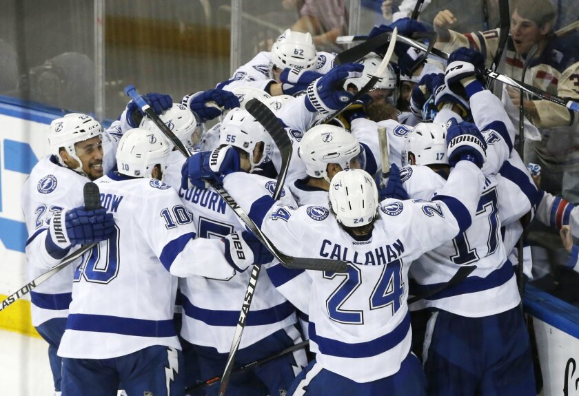 The Tampa Bay Lightning celebrate their 2-0 win over the New York Rangers in Game 7 of the Eastern Conference final during the NHL hockey Stanley Cup playoffs, Friday, May 29, 2015, in New York. (AP Photo/Kathy Willens)