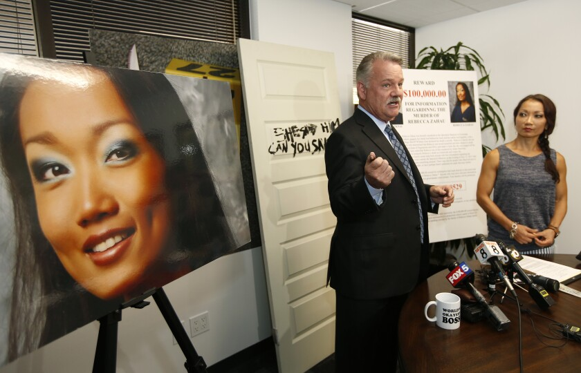 Attorney Keith Greer, left, and Mary Zahau-Loehner, sister of Rebecca Zahau held a news conference Wednesday to offer a $100,000 reward for information regarding the death of Rebecca.