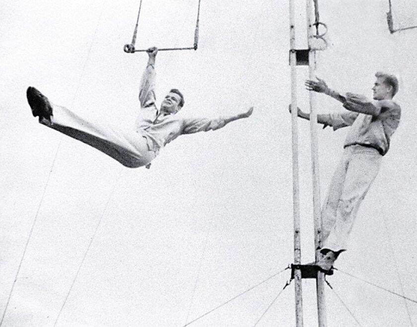 In August 1950, John Witt performed on a flying trapeze as part of a gymnastics performance troupe.