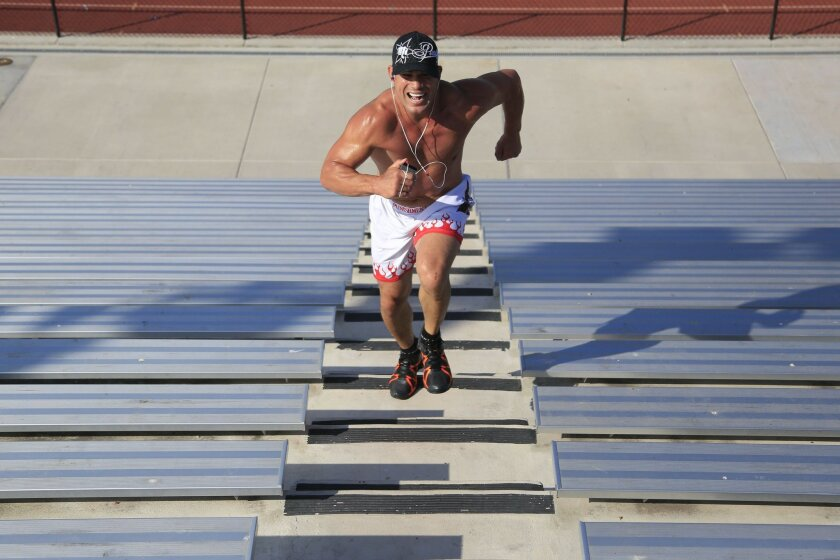 October 11th, 2014 Huntington Beach, CA- Mixed martial arts fighter Tito Ortiz runs the steps at Huntington Beach high school during a fifteen minute cardio workout. Photo by David Brooks/ U-T San Diego MANDATORY PHOTO CREDIT DAVID BROOKS / U-T SAN DIEGO; ZUMA Press.