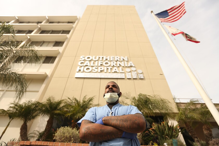 Andre Ross, 30, is a floor-care specialist at Southern California Hospital at Hollywood. He disinfects the floors of patient rooms, including some where possible COVID-19 victims stayed.