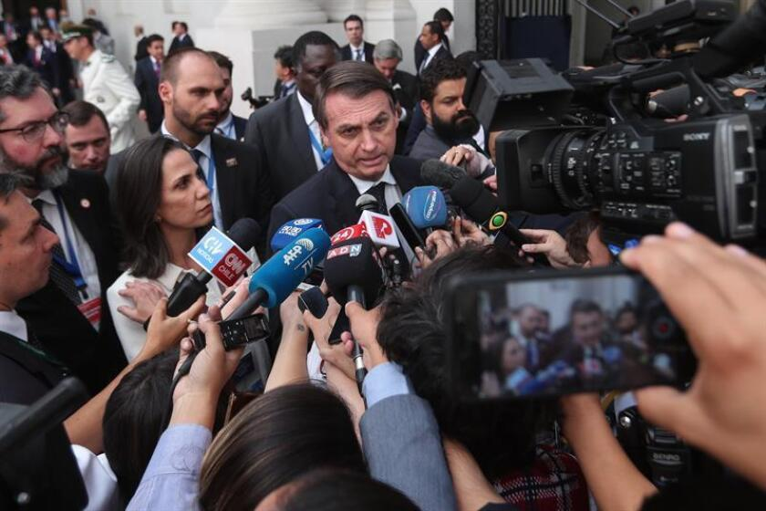 Brazilian President Jair Bolsonaro speaks with the press at a summit in Santiago on March 22, 2019, after signing an agreement for developing an integration project for South America called Prosur. EFE-EPA/Alberto Peña