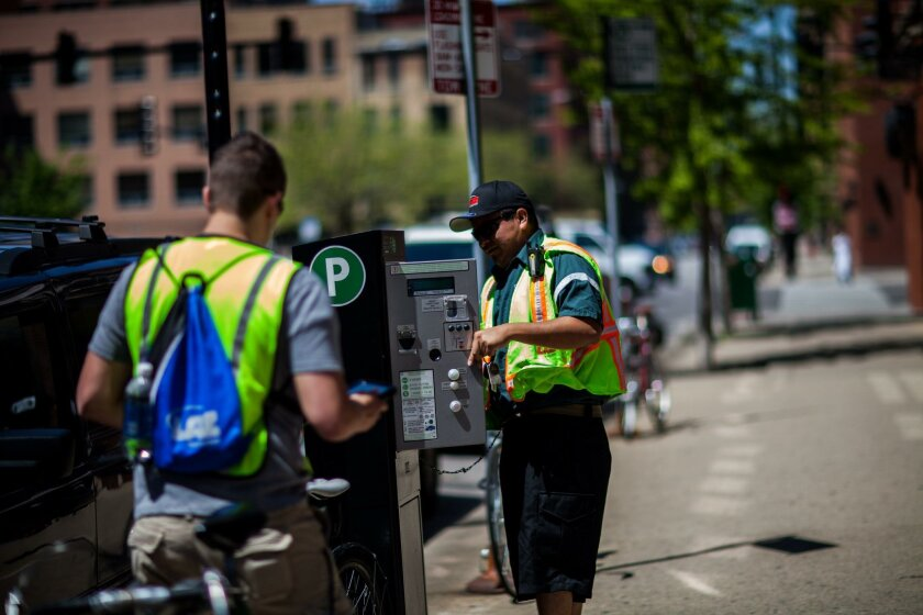 LAZ Parking employees work in the River North neighborhood of Chicago on Tuesday, May 14, 2013. (Zbigniew Bzdak/Chicago Tribune)