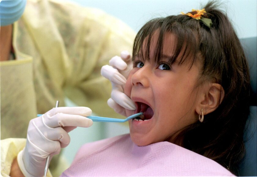 The state's new marketplace for health insurance policies, Covered California, is barring insurers from including pediatric dental coverage in the medical policies they sell through the exchange.