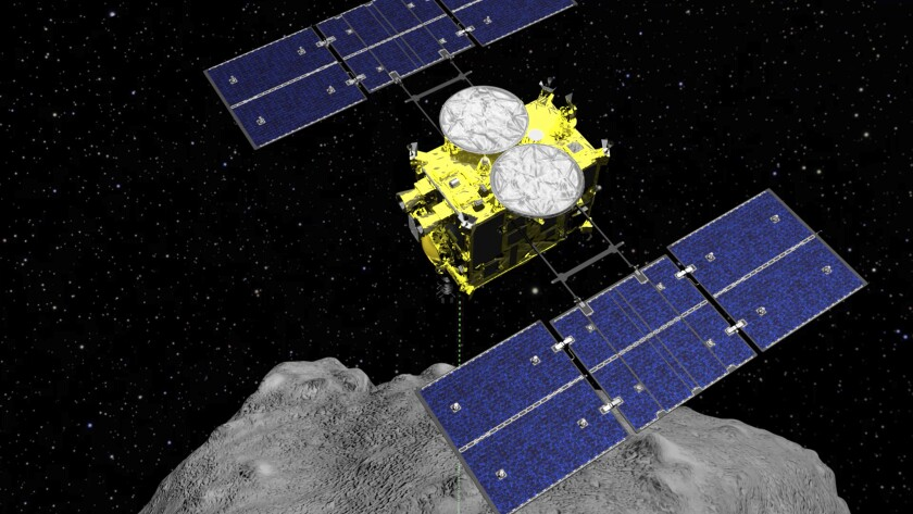 FILE - This computer graphics image released by the Japan Aerospace Exploration Agency (JAXA) shows the Hayabusa2 spacecraft above the asteroid Ryugu. The Japanese space agency said Friday they are all set for the spacecraft′s final approach to Earth this weekend to deliver a capsule containing valuable samples of a distant asteroid that could provide clues to the origin of the solar system. (ISAS/JAXA via AP, File)