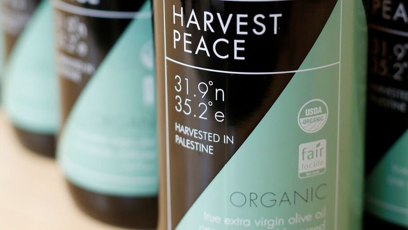 The bottles of Harvest Peace olive oil are printed with the latitude and longitude of the region whe
