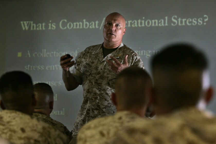 Navy Cmdr. Paul Hammer addresses a class of Marines at Camp Pendleton on how to deal with combat and operational stresses. A new study, using mice, suggests coping skills could be passed on from stressed-out dads, through an epigenetic process.