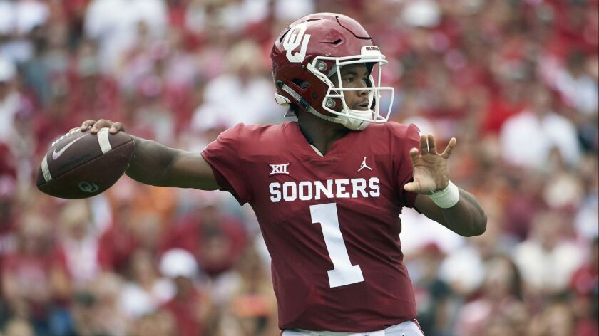 FILE - In this Oct. 6, 2018, file photo, Oklahoma quarterback Kyler Murray (1) throws a pass against