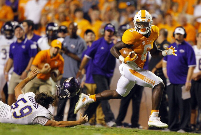 Tennessee running back Alvin Kamara (6) escapes from Western Carolina linebacker Spencer McCoy (59) during the second half of an NCAA college football game Saturday, Sept. 19, 2015, in Knoxville, Tenn. (AP Photo/Wade Payne)