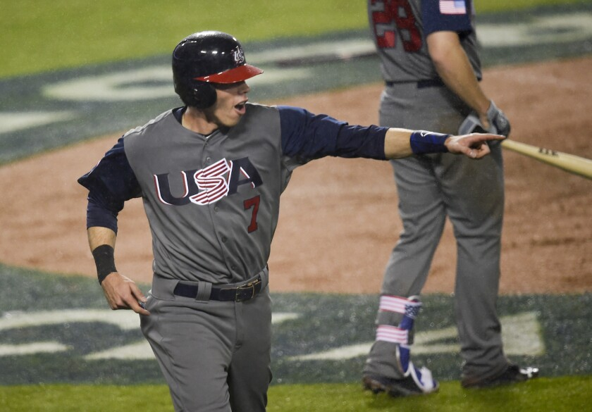 U.S. left fielder Christian Yelich reacts after scoring on a fourth-inning single by Andrew McCutchen during the World Baseball Classic on Tuesday at Dodger Stadium.