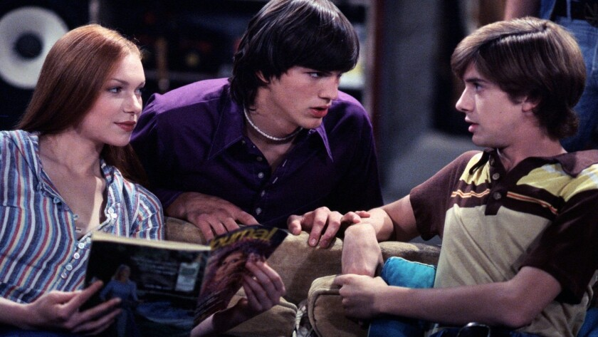 """That '70s Show"" featured Laura Prepon, left, Ashton Kutcher and Topher Grace."