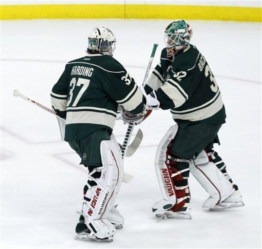 Minnesota Wild goalie Josh Harding (37) replaces Minnesota Wild goalie Niklas Backstrom (32), of Finland, during the first period of an NHL hockey game after Backstrom gave up three goals to the Edmonton Oilers in St. Paul, Minn., Friday, April 26, 2013. (AP Photo/Ann Heisenfelt)