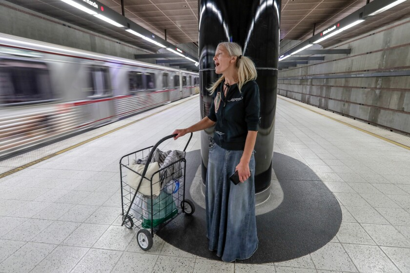LOS ANGELES, CA, MONDAY, SEPTEMBER 30, 2019 - Emily Zamourka, 52, is a viral social media star after an LAPD officer recorded the homeless woman singing opera at a subway station. She sings for a photographer at the Wilshire/Normandie station where she was originally recorded. (Robert Gauthier/Los Angeles Times)