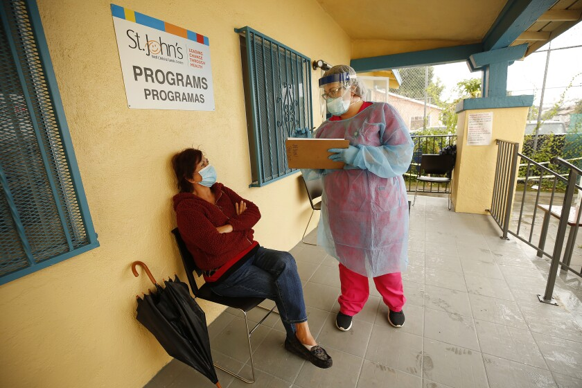 Coronavirus ravages poorer L.A. communities while slowing in wealthier ones, data show