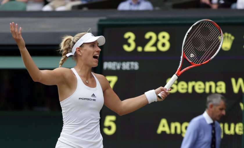 Angelique Kerber of Germany gestures during the women's singles final against Serena Williams of the US on day thirteen of the Wimbledon Tennis Championships in London, Saturday, July 9, 2016. (AP Photo/Tim Ireland)
